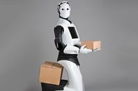 """REEM"" robot carries cardboard box. Pic by Pal Robotics SL  Licensed under CC BY-SA 3.0 via Commons"
