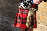 Bagpiper in a kilt. Photo via Shutterstock