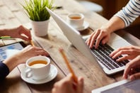 Users with laptop, mobile, tablet have tea in a coffee house. Pic via shutterstock