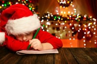 Boy writes a letter to Santa. Pic via Shutterstock