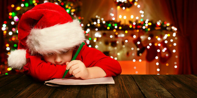 Boy writes a letter to Santa. Pic via Shutterstock
