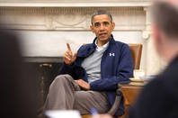 Barck Obama, sitting in chair