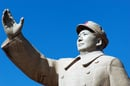 Chairman Mao image via Shutterstock