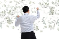 Money falling, image via Shutterstock
