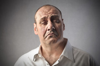 man crying, image via Shutterstock