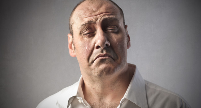 man crying, image via Shutterstock