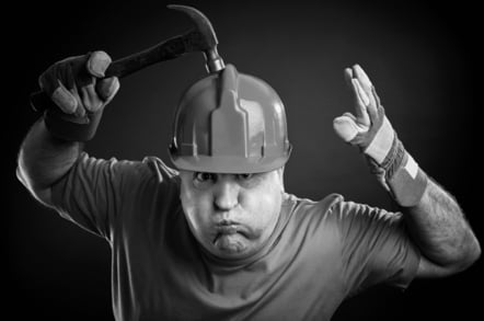 Hammer and hardhat, image via Shutterstock
