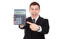 Grinning man in suit points at a calculator meaningfully. Pic via Shutterstock
