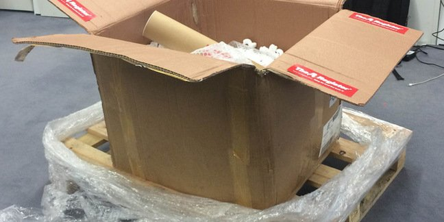 The box atop a wooden pallet