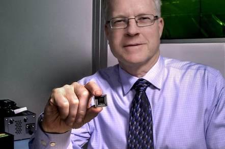 NASA's Mike Krainak with the silicon-photonic chip