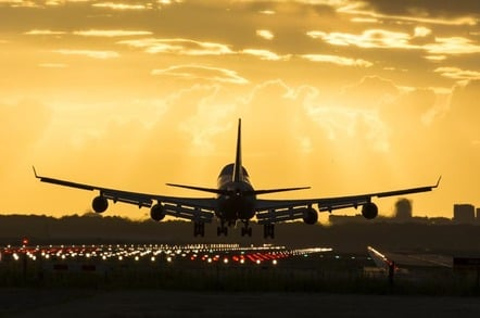 Boeing 747 lands at dusk. Photo via Shutterstock