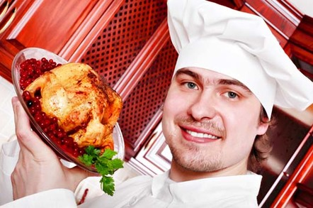 chef presents a roast chicken in pomegranate sauce. Photo by Shutterstock