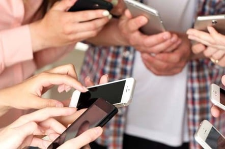 """Young """"creatives"""" whip out their mobile phones. Photo by Shutterstock"""