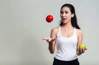 Juggling apple image via Shutterstock