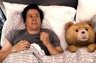 Mark Wahlberg and his come-to-life teddy bear in bed in the movie Ted. Copyright: Universal Pictures