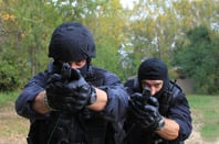 Cops with guns, image via Shutterstock