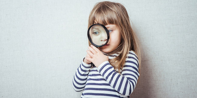 Girl magnifying glass, photo via Shutterstock