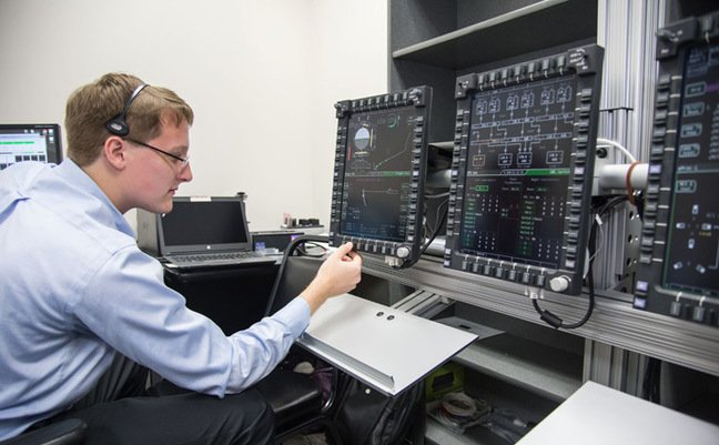 An engineer evaluates Orion's display and control system. Pic NASA
