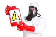 person in chemical repelling suit with a suspicious bottle