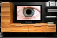 A 'connected' TV watches over its owner. Pic via shutterstock