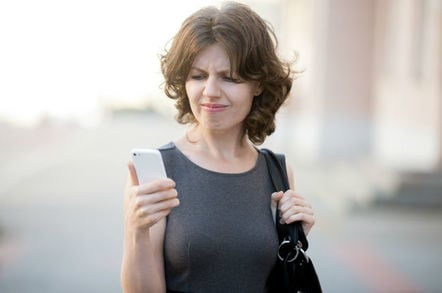 Woman frustrated while trying to make mobile phone call... Photo via Shutterstock