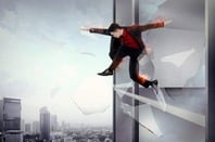 Man jumps out of window of burning building. Pic by Shutterstock