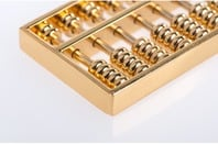 gold abacus via shutterstock