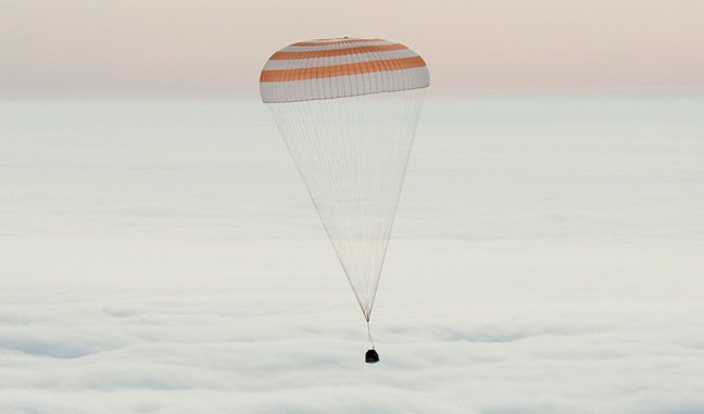 The Soyuz capsule descending under its parachute this morning. Pic: NASA/Bill Ingalls
