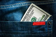 Dollar in pocket, photo via Shutterstock