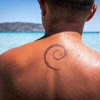 man with debian logo tattoo