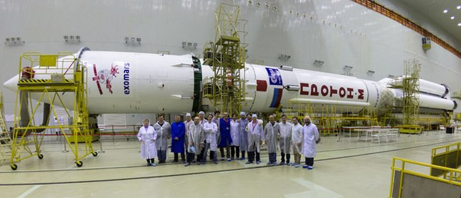 Some of the ExoMars team pose with the payload and the Proton rocket. Pic: ESA