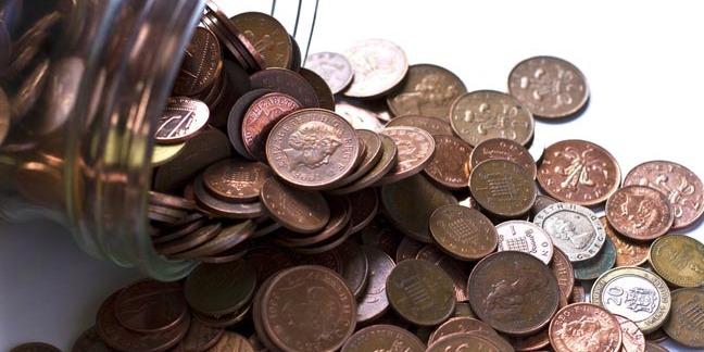 Pennies in a jar. Photo via Shutterstock