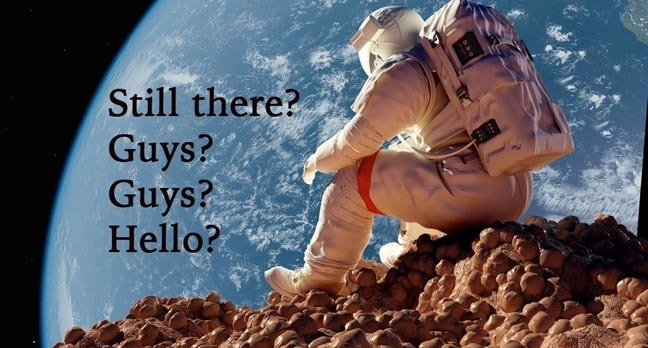 An astronaut sits alone on a rocky surface of another planet. Photo by SHutterstock