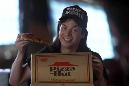 Wayne's World product placement visual gag (Wayne eats Pizza Hut pizza, displays branding, while talking about product placement)