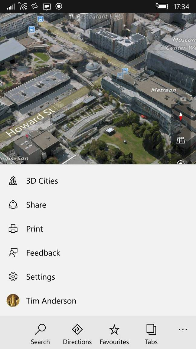 The new Maps app on Windows 10 Mobile showing the bottom menu and a 3D city view