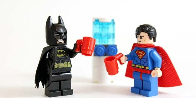Studio shot of LEGO minifigure Batman and Superman standing by a water cooler with drinks. Copyright: cjmacer Editorial Credit: cjmacer / Shutterstock.com Editorial Use Only.