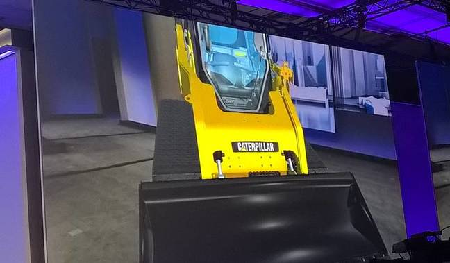 A virtual construction vehicle on stage at Build