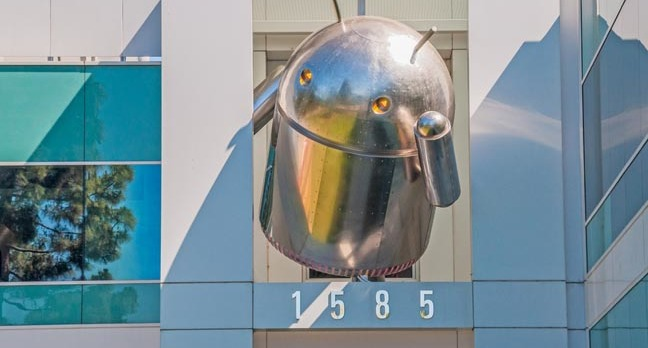 Android figurine (silver) hangs off building at Mountain View HQ. Photo by Nick Fox, Shutterstock.com</a>
