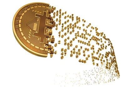 "Illustration of a ""bitcoin"" dissolving into numbers. Photo by SHutterstock"