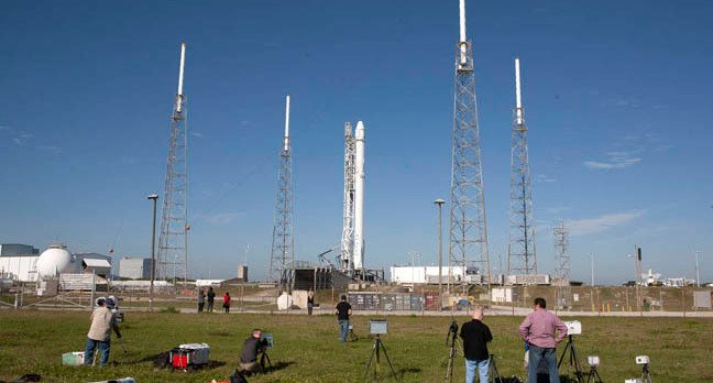As a Falcon 9 rocket stands ready for lifts off at Cape Canaveral Air Force Station's Space Launch Complex 40, photojournalists set up cameras to record the event. The rocket will launch a Dragon resupply spacecraft to the International Space Station, or ISS. Liftoff is scheduled for April 8, 2016 at 4:43 p.m. EDT. On its eighth commercial resupply services mission to the ISS, Dragon will bring up almost 7,000 pounds of supplies, such as new science experiments and equipment for technology research.  Photo credit: NASA/Kim Shiflett