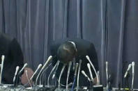 Mitsubishi president bowing in apology