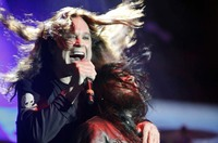 Ozzy Osbourne performing live with his bassist Blasko in 2013. Photo by Harmony Gerber,  Creative Commons Attribution 2.0 Generic