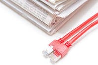 stack of newspapers with a pair of ethernet cables next to them