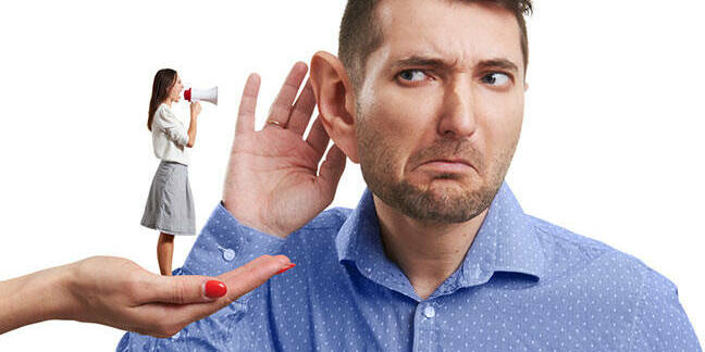 Lady  standing on a hand with a megaphone shouting into mans ear