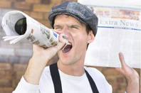 Man shouting the news from a rolled up newspaper