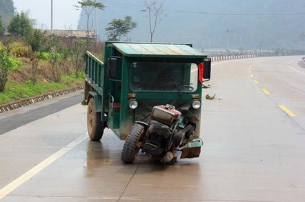 Small truck skids towards side of road as wheel comes loose. Photo by shutterstock