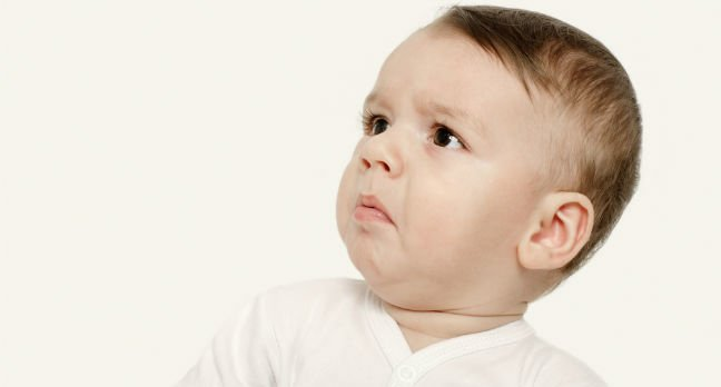 Baby looks taken aback/shocked/affronted. Photo by Shutterstock