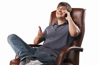 Bloke in leather chair, photo via Shutterstock