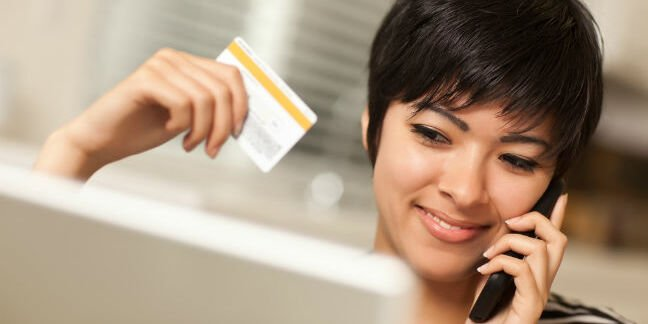 Woman pays for something online with her credit card. Photo by Shutterstock
