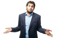 Puzzled man displays his palms in the classic physical pose that tells other people you do not know something or are asking a question. Photo by Shutterstock